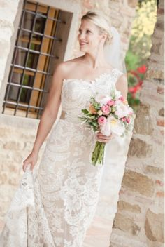 Marissa married in Tuscany wearing a champagne tear drop earring from The Left Bank Jewelry & Bridal Finery