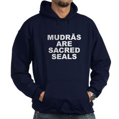 (FRONT) Men's dark color navy blue hoodie with Mudras Are Sacred Seals theme. Mudras itself is a science of directing and stimulating energy with the hand & fingers like a plug or antenna within the body to do detox, balance, repair and more. Available in black, navy blue; small, medium, large, x-large, 2x-large, 3x-large for only $48.99. Go to the link to purchase the product and to see other options – http://www.cafepress.com/stmass