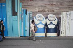 Nike advertising on Tokyo sidewalk by precinct 25, via Flickr