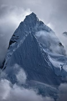 Tibetan Himalayas ~ The Himalayan and the Karakoram are the world's youngest mountain ranges still growing at the rate of 7 millimeters annually as the Indian Geological plate continues drifting north with its northern edge, nosing down under the Asian plate, pushing the mountains upwards.
