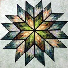 Prismatic Star, Quiltworx.com, Made by CI Martha Penner.