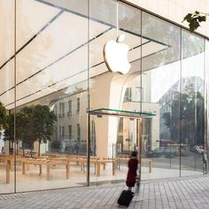 Apple has lifted the veil on the first of its store interiors since Jonathan Ive became chief design officer, at the tech giant's new outpost in the Belgian capital.