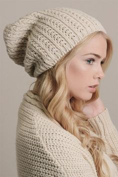 """Keep your noggin warm in our best-selling slouchy beanie. Available in black, grey and ivory. Pointelle knit Circumference 14.5"""" Height 11"""" 100% acrylic Made in China"""