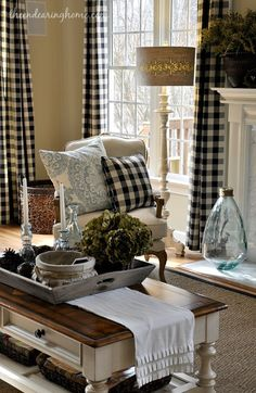 Love the checked curtains and the arrangement on the coffee table