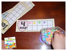 Use Candy Hearts to Fill in 10 Frames ....Valentine Erasers would work great also