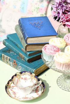 a good book with a cupcake and a cup of tea or coffee
