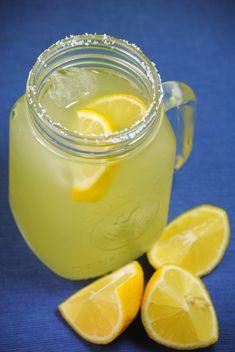 Honey Dew Margarita  salt  lemon wedges  1 cup tequila  1 cup fresh honeydew juice  1/3 cup fresh lemon juice  1/2 cup Cointreau  ice cubes