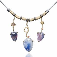 A handmade sapphire necklace by Q Evon jewelry.  This design is from the Eclipse Collection where all styles are unique and one-of-a-kind.