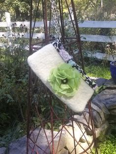 Handmade shabby chic silky flower, vintage button center, small clutch, 100% wool, hand knit, fulled... http://ellenleecollection.blogspot.com/
