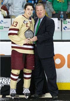Johnny Gaudreau (BC - 13) is awarded tournament MVP. - The Boston College Eagles defeated the University of Maine Black Bears 4-1 to win the 2012 Hockey East championship on Saturday, March 17, 2012, at TD Garden in Boston, Massachusetts.