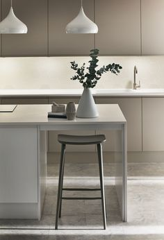Pendant lights give this kitchen island a great focal point and modern look.  Take a look at the Clerkenwell Matt Cashmere Kitchen from the Contemporary Collection at Howdens.