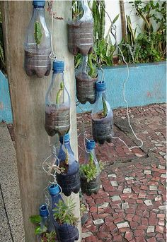 Recycled hanging planter made out of bottles. So doing this in the spring