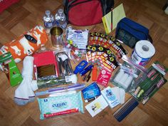 Emergency Car Kit  Energy Bars  Water bottle  Hand and body warmers  Emergency blanket  Strike anywhere matches  Whistle  Flares  Flashlight  Sunscreen  Chapstick  Toilet paper  Small garbage bag  Hand sanitizer  Baby wipes  First aid kit  Comb  Tissues  Pocket Knife  Duct tape  Leather gloves  Jumper cables  Sewing kit  Notepad and pen  Emergency phone numbers