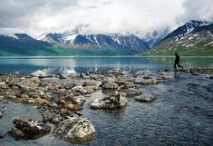 Photo: A visitor on the rocks in Mulchatna River at Turquoise Lake in Lake Clark National Park, Alaska.