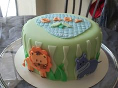 Baby shower jungle themed cake If you're in the Tampa Bay area and need a unique and delicious cake like this, contact me Solia at 813-484-1081 or email me at myangelspartyrescues@gmail.com for prices.