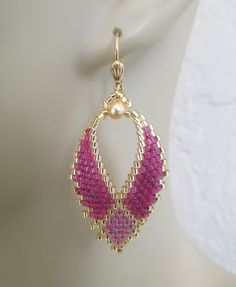 I first created this two-tone pattern style of Russian Leaf earrings back in 2009... thought I would start making these again. I purchased this pattern online (not Etsy) & slightly modified the pattern shape to make it my own. These pretty Russian leaf earrings are handmade with transparent raspberry, color-lined magenta rainbow & golden delica seed beads with golden Swarovski glass pearls. They measure just under 2 long including the leverback earwire. The leaf itself measures ju...
