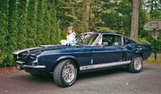 My daughter Shelby sitting on our 1967 GT-500 Shelby. She's in college now, and the car moved on to new owners many years back. Ah, the old days. Such fond memories.