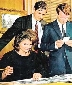 Mrs. Kennedy and brother-in-law Robert look over plans for the JFK library.