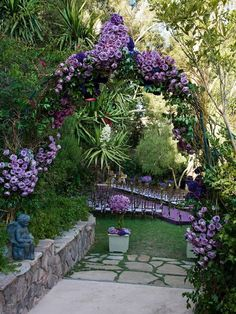 21 Modern Garden Arches Covered with flowers... Archways add a fantastic touch to any garden with beautiful flowers. Archways can made of many materials like wood and metal, also you can cover them with different plants and colored flowers in white, red, pink, purple flowers.  Click for 21 pictures of different archways to get an idea for your garden.