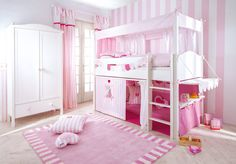 Bold all-pink childs bedroom with pink rug and bunk bed by annette frank gmbh