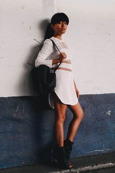 "Olivia Lopez of ""Lust For Life"" goes for laidback luxe with an Alexander Wang x H&M white perforated top & black heeled ankle boots. 