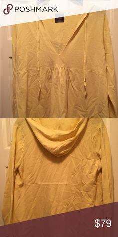 100% cashmere butter yellow baby doll hoodies This super soft yellow 100% cashmere sweater has a plunging neck line empire waist full swing bottom complete with a hoodie. Where as a tunic or as a top. Nothing is softer than Cashmere Sweaters