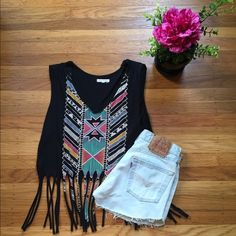Festival Black & Print Crop Top with Fringe Black crop top with colorful print and long fringe. Size medium. EUC. Fun festival shirt! Shorts not included. Urban Outfitters Tops Crop Tops