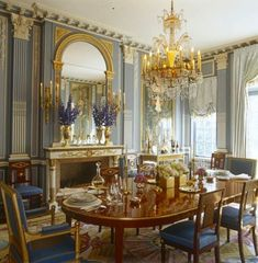 This Long Island dining room Brian J. McCarthy is dripping in opulent, old world style, yet is still pretty darn livable and cool. You can't really beat powdery grey-blue, cream, gold, and shiny mahogany.