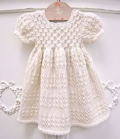 the most adorable baby dress!! hand-knit + organic too.