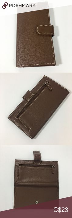 Leather Wallet Wilsons Leather Women's Brown NWT Genuine Leather  Brand: Wilsons Leather Unused - New with Tags Brown with cream/white stitching. Snap closure Outside: zip change pocket Inside: checkbook pocket, pen holder, credit card holders, cash divider, ID window. Dimensions: 6.75 x 3.75 inches.  Approx. 0.5 inches thick, without anything in it. Wilsons Leather Bags Wallets Leather Bags, Leather Wallet, Cream White, Card Holders, Stitching, Wallets, Divider, Window, Closure