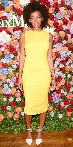 SOLANGE KNOWLES Anyone else hearing Natasha Bedingfield's Pocketful of Sunshine in their head right now? Solange brightens up the Max Mara fête in a yellow Sportmax sheath, plus white ankle-strap pumps and bubble gum pink lips.