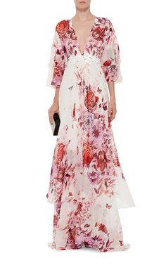 Sweet, romantic and ready for the after party: a definite festive sensibility permeates Giambattista Valli's sister line. This **Giamba** dress dazzles in a maxi length with layered flutter sleeves and floral appliqué.