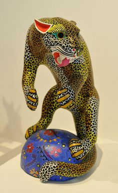 This fierce carved wood jaguar was included in an exhibition of alebrijes (fanciful creatures) at the Museo de Arte Popular in Mexico City, Mexico Day Of The Dead Artwork, Paper Mache Crafts, Wood Animal, Colorful Animals, Arte Popular, Wooden Art, Mexican Folk Art, Wood Carvings, Carved Wood