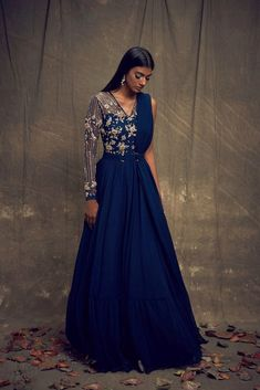 Teal georgette one-shoulder draped anarkali with gold hand embroidery and a pleated net hem paired with a gold metallic belt Indian Gowns Dresses, Indian Fashion Dresses, Dress Indian Style, Indian Designer Outfits, Pakistani Gowns, Fashion Outfits, Designer Party Wear Dresses, Designer Gowns, Desi Wedding Dresses