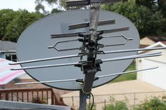 Turning an old satellite dish into an HDTV antenna. We did a cheap version of this last weekend and it worked fabulously. Once the cheap antenna we put up there gives out, we'll get a new one, and do this!