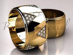Peso aproximado do par 19 gramas Ouro Amarelo 18k / 750 Diamantes apidação brilhante Acabamento polido Largura 11 mm