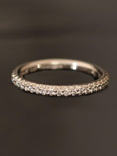 Michael B. Platinum Princess Collection Eternity Band. Micro pave set diamond eternity band with diamonds equaling approximately .46ct total weight. Available at London Jewelers!