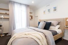 Warm neutral tones with crisp white linen bedding and some nav to contrast looks stunning. This is a master bedroom reveal from The Block NZ. Get this look with Feltex wool carpet. #regram @freedom_nz#feltex #feltexcarpet #woolcarpet #theblocknz #theblock #theblocknz2016 #interiors #greycarpet #wool #interiordesign #homedecor