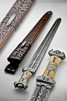 Einhärjar  Blade: Two types of Damascus laminated steel with nickle stripe. Explosion in the center and random Damascus on top.    Handle: Damascus, etched 925 silver, gold plated details and brown fossil walrus.    Sheath: Rawhide leather sheath with silver and Damascus details.