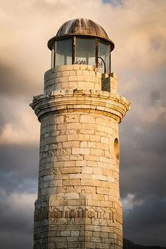 "Crete, Rethymnon: The lighthouse .................. #GlobeTripper® | https://www.globe-tripper.com | ""Home-made Hospitality"" | http://globe-tripper.tumblr.com/"