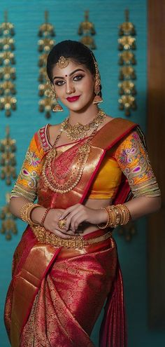 In a bridal look in a red color pattu / kanjeevaram saree, orange color elbow length sleeve blouse design, necklace, hip chain, maang tikka / head piece and jewelry Indian Bridal Lehenga, Pakistani Bridal, Indian Beauty Saree, Bridal Sarees, Indian Sarees, Saree Jewellery, Bridal Jewellery, Jewelry, Most Beautiful Indian Actress