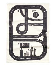 White/car track. Rectangular cotton rug with a printed pattern at front and non-slip backing.