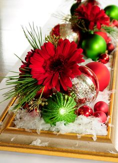 Lay an old frame or mirrror on the table and fill with snow, ornaments, pine boughs, and flowers...very striking!