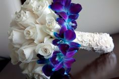 White roses and blue orchids bouquet-love this.... I want this with sunflowers instead of roses