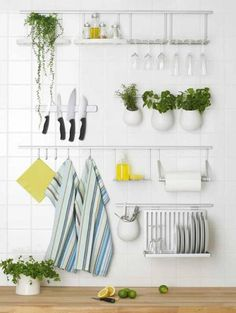 Get things off the counters, out of the drawers and on the wall in a small apartment kitchen.