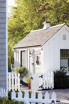garden shed + white picket fence