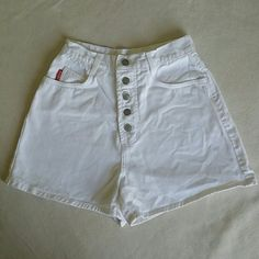 Vintage White High Waist Bongo Shorts On trend and Vintage chic, BONGO white button down high Waist shorts size 9Jrs. Has minor piling on right back pocket and a tiny brown spot as pictured above. Otherwise in excellent used condition. Price per condition. 100% cotton. Machine wash.   Measurements are : 12 1/2' waist / 18' hip  11' rise/ 3 1/2 inseam. Please let me know if you have any additional questions before purchasing. No modeling. No lowballs! No trades! BONGO Shorts Jean Shorts