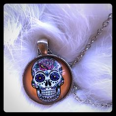 Vibrant Sugar Skull Glass Cabochon  Very vibrant and beautiful statement necklace. This necklace is made of alloy metals and glass. It has a good weight to to it. Small chips in the alloy around the charm. Price is final unless bundled. No offers please. Jewelry Necklaces