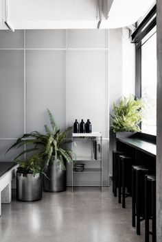 Concrete and terrazzo furniture feature in Ritz&Ghougassian's minimal cafe interior