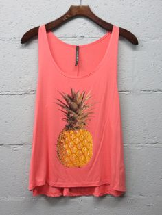 Loose fit pineapple tank in coral. Perfect summer tank in a great color! Pair with cutoffs and flip flops or a maxi skirt!